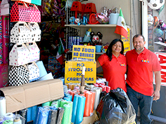 Mirna Aracely Garcias and her husband outside her business, La Fiesta Party Supplies and Gifts