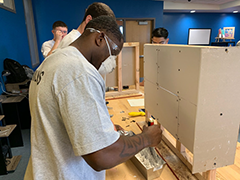 Compass Rose Collaborative construction training participants learning carpentry skills