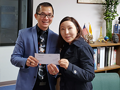 (left to right) Central West Region BSC Business Loan Counselor Phuong Le presenting Jean Kwon, owner of JK Law Firm, with a $100,000 SBA working capital loan