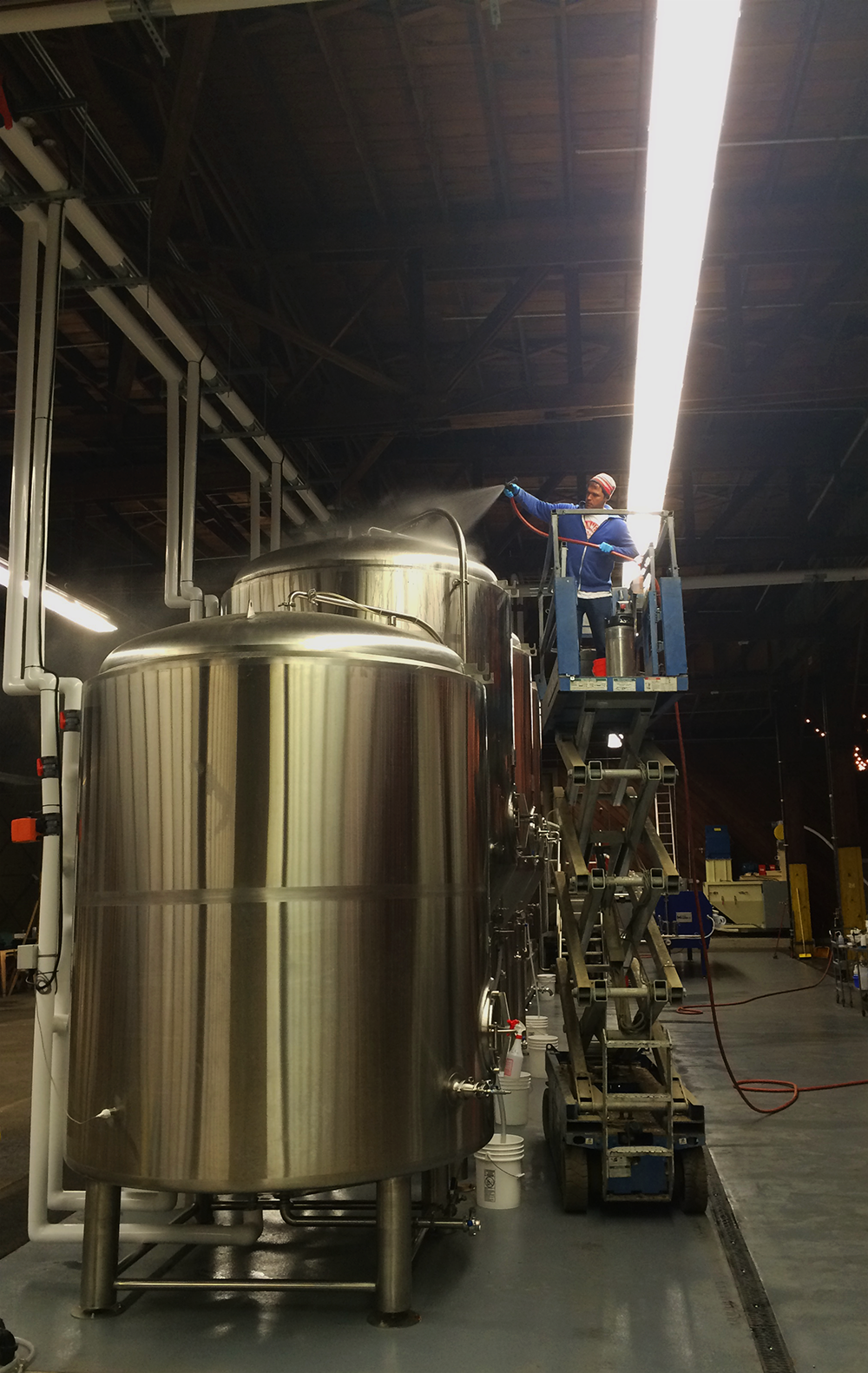 Brian Mercer, Brouwerij CEO & founder, cleaning the cutting edge, green brewing tanks