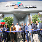 EWDD General Manager (second from left) Deputy Mayor Brenda Shockley and Councilman Curran Price (second from right) celebrate the grand opening of the new CRCD Enterprises facility