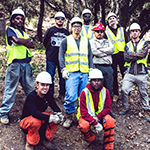 Brian (center, standing) and Christopher (left, seated) pictured with their Creek Wildfire restoration crew funded through the National Dislocated Worker Grant