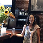 Elizabeth Peterson Gower, owner of Clayton's Public House in downtown LA, poses in front of her Victorian-era style portrait in the restaurant