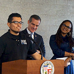 Eric Rodriguez (left) an entertainment industry intern through HIRE LA's Youth Program, appeared with LA Mayor Eric Garcetti (center) and filmmaker Ava DuVernay (right) at a press conference announcing the Evolve Entertainment Fund, a program designed to help youth gain similar opportunities at leading digital media and entertainment companies