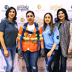 "(left to right) Theresa Cordero, carpenter apprentice Nataly Portillo, LAYOM Watts intern Daize Ayon, and Toni Cordero worked to help launch ""The Wardrobe,"" a professional clothes closet at the LAYOM Watts"