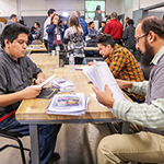 LAVC Advanced Manufacturing graduates meeting with prospective employers immediately after their graduation ceremony on March 20, 2019