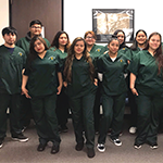 16 Para Los Niños participants after graduating from a Certified Nursing Assistants training course