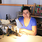 Oksana Putyatina, owner of RadSeams, obtain a $3,000 loan through BusinessSource to expand her clothing business