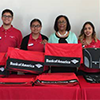 EWDD General Manager Jan Perry (center) with the Bank of America interns at the USC University Village grand opening event on August 17, 2017