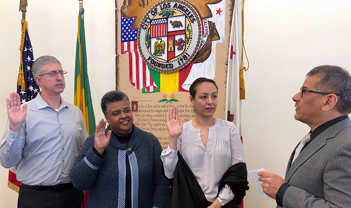 (left to right) Paul Edwards of UFCW, Michelle Crenshaw of International Cinematographers Guild, and Maria Turrubiartes of the California Department of Rehabilitation with LA City Clerk Michael Espinosa administering the oath of office